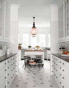 Black and White Tile                                                          Schindler kept continuity with the kitchen by extending the black-and-white tile through the pantry into the room.