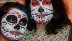 Mother and daughter painted for Day of the Dead celebration.