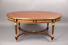 A Rare and Fantastic Quality Late 19th Century Louis XVI Style Gilt Bronze Mounted Inlaid Marquetry and Parquetry Center Table By François Linke