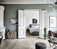 Green is known for balancing mental, emotional and physical energies (which is why it feels so great to walk in the countryside). This lovely Swedish home combines calming sage green and grey for a wo