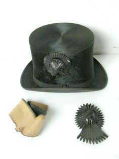 347a4efed93 A spare cockade for a black top hat with rosette type decoration on the  side
