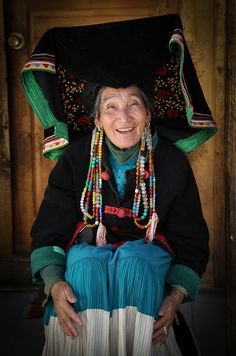Lady in traditional dress with big hat