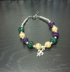 Mardi Gras disco bead bracelet accented with by UniquelyInGauging, $11.25