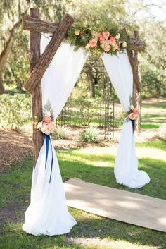 rustic ceremony arch with drapery and florals-Pink and Blue Wedding-Cross Creek Ranch in Dover, FL - Photo: Corner House Photography- Orange Blossom Bride-Orlando Wedding Blog