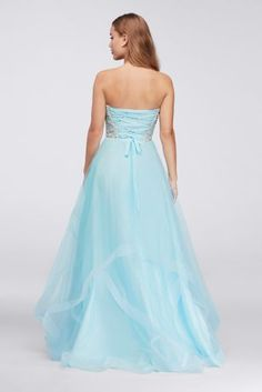 Just about as dreamy as it gets, this sweetheart ball gown features a crystal- and pearl-embellished sweetheart bodice and waves of tulle.   By Glamour  Polyester  Back zipper; fully lined  Dry clean  Imported  Also available in plus size