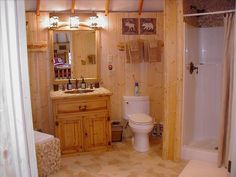 fully enclosed,heated, yurt bathroom with pebble tile vanity,shower and toilet.