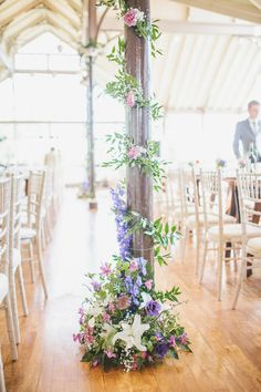 A Wild Flower Inspired and Locally Sourced Wedding in Northumberland | Love My Dress® UK Wedding Blog. Pretty decoration for columns etc
