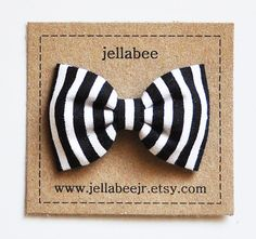 just found this seller on etsy with the cutest, old school looking bows for little girls.
