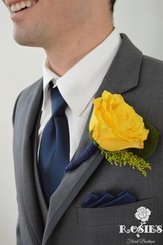 Yellow rose boutonniere for groomsmen with grey suits and navy tie!
