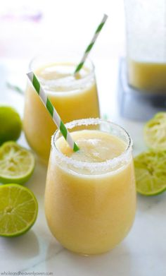 You'll feel like you took a trip to the tropics after one sip of these icy-cold, tropical-style margarita slushies! 5 minutes and a few basic ingredients is all you need! @WholeHeavenly