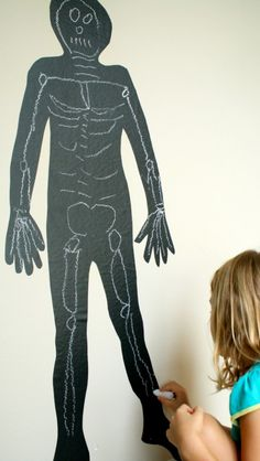 Chalk Skeleton Art and Learning Activity ~ Use this fun idea to learn about the skeletal system or use colored chalk and invited kids to create their own art! #Halloween #prek (repinned by Super Simple Songs)