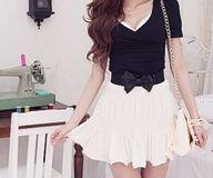 Love the skirt, and the bow makes it even cuter!