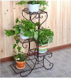 multi-floor-balcony-wrought-iron-flower-stand-shelf-parlor-fleshy-for-flowers-bonsai-plant-pots-trapezoidal.jpg (492×534)