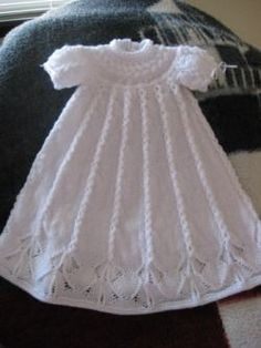 Cabled Yoke Christening Gown for a baby knitting pattern designed by Judy Lamb. Find the free pattern here: link A feather and fan stitch gives a light texture to this baby blanket knit in two colors of Bernat Baby Sport. More Patterns Like This! Easy Crochet Patterns, Baby Knitting Patterns, Baby Patterns, Dress Patterns, Knit Baby Dress, Knitted Baby Clothes, Baby Knits, Baby Cardigan, Knitting For Kids