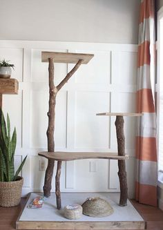 A DIY Cat Tree tutorial - how to make your own cat play tower on the cheap using real branches and supplies you might already have on hand! Cat Play Tower, Diy Cat Tower, Homemade Cat Tower, Cat Trees Cheap, Diy Closet System, Cat Tree Plans, Billy Ikea, Cat Towers, Diy Chicken Coop
