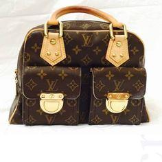 Authentic Louis Vuitton Manhattan PM Louis Vuitton Manhattan PM gently used. Still in great condition. Original price is $1299 plus tax. Louis Vuitton Bags