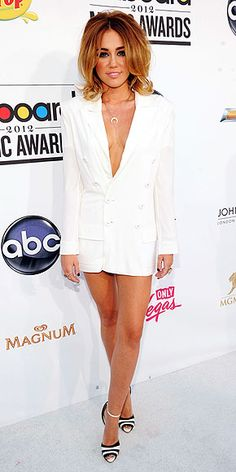 Miley Cyrus in a Jean Paul Gaultier blazer.  I would have chosen a different cut for a blazer, but still like the look and the black and white pumps really pull the look together.