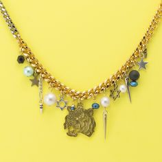 """CLOCH"" handmade jewelry   http://www.cloch.jp  #Handmade #Necklace #Tiger #Pearl #Spike #Star #Beads #CLOCH #Mye"