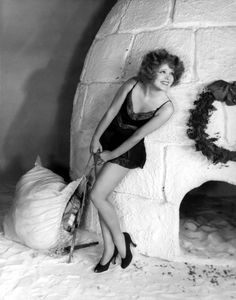 Vintage Christmas pinup: Clara Bow in her skimpies outside an igloo