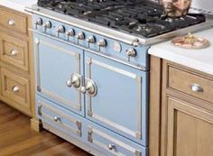 French company: La Cornue CornuFé stove. The stove fits in with standard 24″ deep base cabinets, and it is height adjustable. It's available in several colors (Provence blue, burgundy, ivory, stainless steel, and black). The fittings are offered in your choice of satin chrome or satin chrome with polished brass accents. The double oven model is $8,600 at Williams Sonoma.