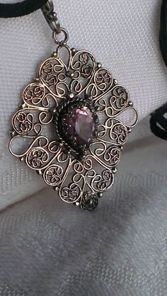 Sterling silver filigree pendant with amythyst. Handcrafted.