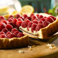 Pepperidge Farm Puff Pastry: Lemon Raspberry Tart Recipe. A chocolate-coated puff pastry crust is filled with homemade lemon curd and topped with fresh raspberries for a dessert that will make your guests rave!