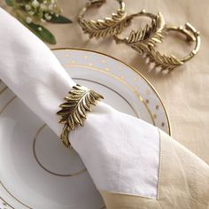 Unique napkin rings are one of our favorite ways to dress up the dinner table for changing seasons and holidays. Our Winter Greenery Napkin Rings are handmade of solid brass with beautifully detailed leaf motif on top and a branch style ring. These unique napkin holders are detail Christmas Decorations that really shine. #ChristmasDecor