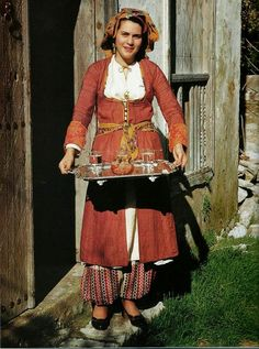 Europe | Portrait of a woman wearing traditional clothes, a saya, a dress with trhee panels, Karpasia, Cyprus