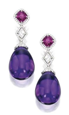 PAIR OF PLATINUM, 18 KARAT WHITE GOLD, AMETHYST, PINK SAPPHIRE AND DIAMOND EARRINGS Anchored by two pear-shaped cabochon amethyst drops weighing 67.45 carats, topped by two lozenge-shaped diamonds weighing .76 carat, suspended from two cushion-cut pink sapphires weighing 3.14 carats, accented by round diamonds weighing 1.80 carats.