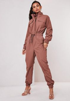 brown high neck long sleeve utility style jumpsuit, featuring a zip through fastening and a drawstring waist. regular fit Ankle Grazer - Sits on the ankle bone Polyurethane pilar wears a UK size 8 / EU size 36 / US size 4 and her height is Long Jumpsuits, Jumpsuits For Women, Estilo Jeans, Balloon Pants, Missguided, Drawstring Waist, Blue Denim, Ideias Fashion, Rompers