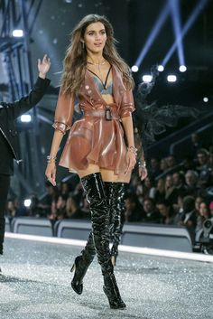 Valery Kaufman wearing transparent Latex Rubber coat and black patent thigh high boots at Victoria Secret fashion show