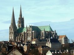 Chartes Cathedral rising above the surrounding town. Notice the flying buttresses.
