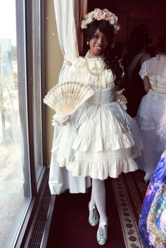 taratiki17:      A few photos from the Secret Rose Boudoir tea party I attended~ It was my first tea party and my first lolita coord. I had an amazing time!     also here~      Dress: Innocent World     Blouse: Krad Lanrete     Head Dress: Handmade     Shoes: Offbrand     Tights/gloves: Taobao     Fan/Jewelry: Vintage  (via colormelolita)