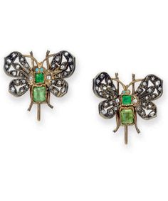 A PAIR OF ANTIQUE EMERALD AND DIAMOND EAR CLIPS  Each designed as a butterfly, the body set with two rectangular-cut emeralds, extending openwork rose-cut diamond wings, mounted in silver and gold, late nineteenth century