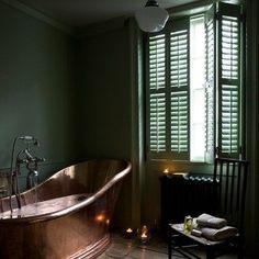 dark room? ...copper bathtub + green