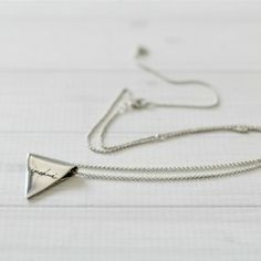 Wear your words you way with our new silver Wordsmith triangle.  A sterling silver folded triangle approximately 23mm wide. Includes sterling silver belcher chain with jump-rings at 45cm... https://www.uberkate.com.au/products/necklaces/wordsmith/