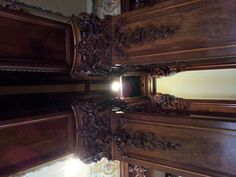 The beautifully carved wood columns that create the entrance to the Music Room at the Swedish Institute