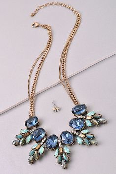 Stunning statement necklace with vintage gold and blue and aqua jewels. Can wear with anything. www.firstandchic.com.