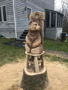 Mountain Mike Ayers, Facebook.  Chainsaw carving, bear on a chair