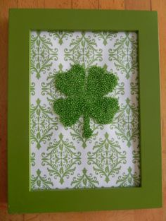 such a cute idea...trace a fourleaf clover on scrapbook paper with glue and cover in seed beads...super cute and cheap