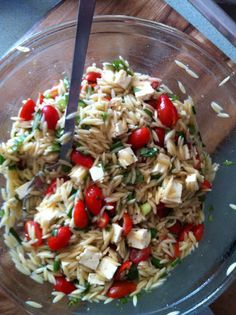 Mmm. I LOVE orzo. Summer be here now!  caprese orzo salad  1/4 cup red wine vinegar  1 teaspoon honey  1/2 cup olive oil  1 pound orzo  1 pint small cherry tomatoes, halved  1 bunch green onions, chopped  1 cup chopped fresh basil  1 7-ounce container feta cheese, cut in to 1/4-inch cubes  salt & pepper to taste