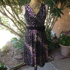 REDUCED Black floral print sleeveless dress NWT REDUCED Black floral print sleeveless spring and summer dress. 96% polyester, 4% spandex waistband has flowers on it. . Worn one time to a shower. Great condition. Apt. 9 Dresses