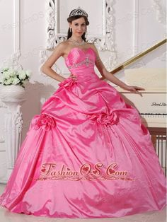 Modest Hot Pink Quinceanera Dress Sweetheart Taffeta Beading and Hand Made Flowers Ball Gown  http://www.fashionos.com   They show just enough skin to be classy without being too revealing. This one features gorgeous beading on the bodice center as well as the top bustline. The amazing A-line skirt is reminiscent of the old fashioned hoop skirts and is made from several layers of pieced fabric that add another dimension of beauty to an already lovely gown.