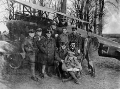 Manfred von Richthofen, a.k.a. the Red Baron (seated in the cockpit of the Albatros D. III) with Jasta 11, including his brother Lothar (seated on the ground), April 23rd, 1917. Von Richthofen was a German WWI ace-of-aces (officially credited with 80 air victories) in the Luftstreitkräfte,