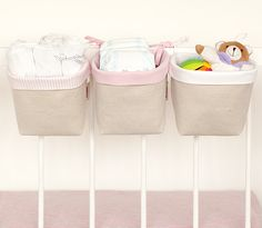 Three fabric boxeswith lacesfor tyingon the baby's bed, crib or hanging  rod.  Also suitable for placing ona changing table or shelf. This is a great  solution for storing baby toys and other things. These fabric boxes are made of two layersof high quality canvas and cotton fabric.