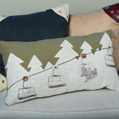 "Ski Lift Ride Pillow Dreaming of a day on the slopes? Lift your spirits with this playful accent pillow featuring a hand painted block print ski lift scene accented with brown leather cable line and button pulleys. Rustic snowy trees in white burlap against an army green body fabric blend nicely for chic retreat lodge decor. Hidden zipper closure over polyfill pillow insert included. Cotton-polyester (15""Hx26""W) Made in America."