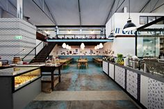 Based on the ideal of an Italian garage, where tomato passata making occurs, fresh pasta is hung to dry and home made wine is stored,Gordon Street Garage provides warmth and energy to a sleepy industrial area of West Perth.