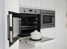 Does your oven open the wrong way? Because it's what we know, we expect oven doors to open outwards and down. But that means you have a hot oven door that Kitchen Layout, New Kitchen, Kitchen Design, Kitchen Ideas, Kitchen Board, Wall Oven Microwave Combo, Layout Design, Design Ideas, Modern Ovens