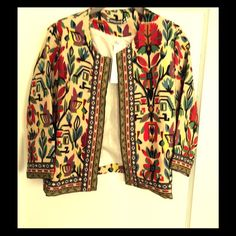 Lined Print Jacket Very pretty jacket!  Body is fully lined, arms are not.  Goes with everything from jeans to dresses, to skirts etc.  brand new, never worn.   Shorter length, comes to just about waist line, depending on how tall u are.  Multicolor on cream background. Genolanven Jackets & Coats Blazers
