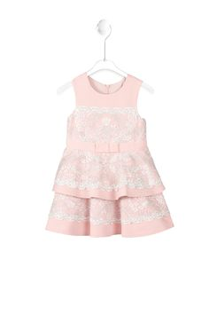 Tadashi Shoji Kids l Children will fall in love with our tiered ruffle skirt dress that features silver embroidered lace. A dainty grosgrain ribbon belt completes the adorable look.
